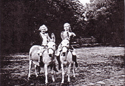 Kids on donkeys, before 1945